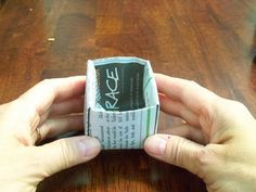 Newspaper pots--folded, no tape, so it's ACTUALLY okay to plant in the ground.  Fun project!