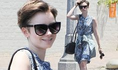 Lily Collins in summer frock after partying at the LA Pride Parade