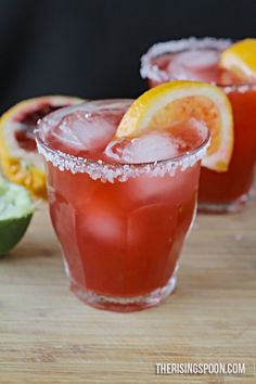 Blood Orange Margaritas -- Homemade margaritas made with fresh blood oranges, limes, raw honey (or simple syrup), and 100% agave silver tequila. This drink recipe looks beautiful (blood oranges give it a wonderful hue) and goes down easy! | therisingspoon.com