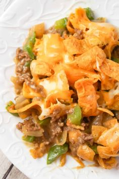 Philly Cheese Steak Frito Pie is an easy ground beef casserole recipe loaded with green peppers, onions, Fritos corn chips and shredded mozzarella and cheddar cheese. Easy Ground Beef Casseroles, Ground Beef Recipes Easy, Beef Recipes For Dinner, Vegan Recipes Easy, Diet Recipes, Family Recipes, Recipies, Goulash With Corn, Beef Goulash