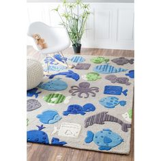 $231.29 Fun playful pattern and bold colors makes up this fabulous kids rug. This rug is hand-carved for a bold and unique textured effect.