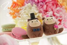 Adorable!!  Bride and groom otter ocean theme Wedding Cake Topper by kikuike, $110.00
