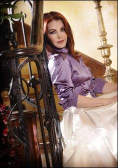 Priscilla Presley Her natural hair color was a light red, Elvis told her men loved jet black long hair. So why'd she cut it?