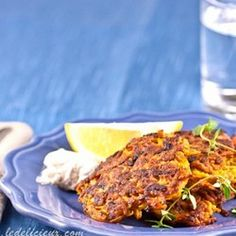 Carrot Fritters Ingredients For Carrot Fritters 6 carrot (peeled and coarsely grated) 6 spring onion (finely chopped) 1 tsp ground cumin 1 tsp ground coriander 1/2 cup coriander (fresh, cilantro chopped) 1 garlic cloves (minced) 2 beaten eggs 1/2 cup flour 1/2 tsp sea salt 2 tbsps oiled