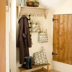 This shabby-chic peg rail shelf makes a handy spot for these pretty oilskin bags, while the wooden bench is ideal for shoes.