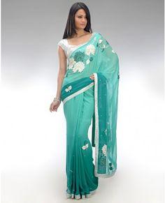 white and turquoise sari