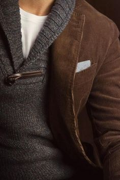 Brown corduroy jacket layered over a gray wool shawl neck sweater and white t-shirt.