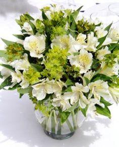 alstroemeria - small lily, inexpensive, comes in white, pink, apricot, rust, yellow, purple & lavender