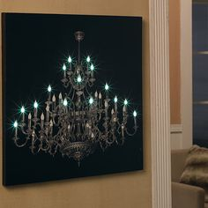 "LED CHANDELIER CANVAS $59.00 - It looks like a photograph printed on canvas, but that's only part of the story. Flip the rocker switch on the side and the image glows with tiny LED lights. A fresh new way to create ambient lighting in any room of your home. Hangs from a groove in back. Takes 2 AA batteries (not included). 24"" square."