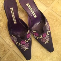 Manolo Blahnik shoes Purple Manolo Blahnik with floral embellishments.preloved, loose threads as shown in the last picture. Reasonableoffers welcome. Manolo Blahnik Shoes