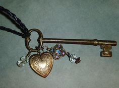 Vintage skeleton key with heart locket crystals and tiny rose
