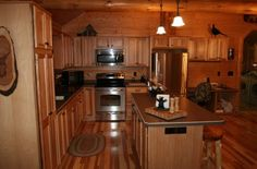 These hickory cabinets are in our standard price range. Golden Eagle Log Homes has many cabinet styles and finishes available. All custom tailored to your taste.