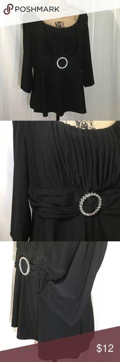 "KSL BLACK Ruched Empire Waist Top w Rhinstones Black dressy top has a gathered front bodice and horizontal pleated waistband with round rhinestone adornment. Sleeves are 3/4 and flare at the hem. Originally part of a set. Good used condition without pics or stains. Length 25"", chest 2 flat. Shoulders at seam 18"". KSL Karin Stevens Tops Blouses"