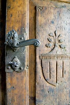 Amazing carved antique door with beautiful hardware.