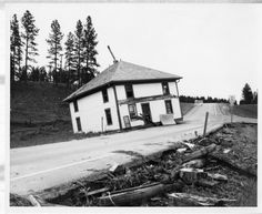 Flood damages, June 9 1972. This two-story home was floated up off it's foundation, moved about 200 yards and deposited on the Highway 16 access road to Rockerville.