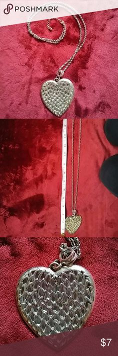 Victoria's Secret heart necklace Victoria's Secret heart necklace is a longer, chunkier piece of jewelry. As you can see the charm in the palm of my hand is big. The front of the necklace, in which pictures don't do justice, has a shiny, glimmer appearance and as you can see on the back it has a mirror-like effect. The chain is 15 inches long at its shortest and 18 inches at its longest because of the extender.  The charm itself is 2 1/2 inches in length. Victoria's Secret Jewelry Necklaces