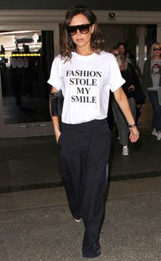 Victoria Beckham from The Big Picture: Today's Hot Photos The fashionista is spotted wearing one of her own tongue-in-cheek t-shirts from the Victoria by Victoria Beckham collection while arriving at LAX airport.