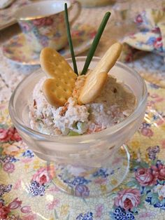 Chicken salad with butterfly cracker & chive garnish