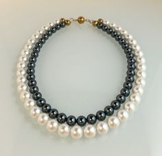 "Japanese glass pearls, 19"" length, magnetic clasp."