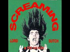 """Screaming Lord Sutch And The Savages (She's Fallen In Love With The Monster Man)Screaming Lord Sutch was a musician from the United Kingdom, known for his horror themed stage show, dressing as Jack the Ripper, pre dating the shock rock antics of Alice Cooper. Accompanied by his band, the Savages, he started by coming out of a black coffin. Other props included knives and daggers, skulls and """"bodies""""..."""