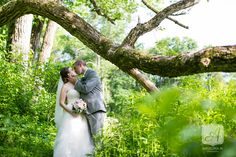 bride and groom kissing under tree at mountain lakes house wedding in princeton, nj   summer lakeside wedding   Angelina M Photography