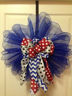 Decomesh door art with red white and blue chevron polkadot bow