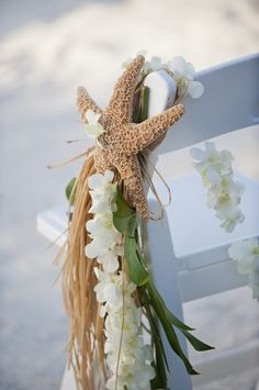 Use leis to decorate your pews for your beach wedding or tropical wedding ceremony. For more beach wedding ceremony decor ideas visit: . Wedding Ceremony Ideas, Beach Wedding Aisles, Wedding Aisle Decorations, Wedding Themes, Our Wedding, Beach Weddings, Wedding Photos, Beach Ceremony, Wedding Vendors