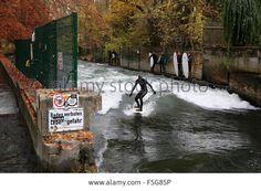 Munich, Germany. 4th November, 2015. #Surfers on a sunny autumn morning in the Englischer Garten park in #Munich Credit:James Boardman / Alamy Live News