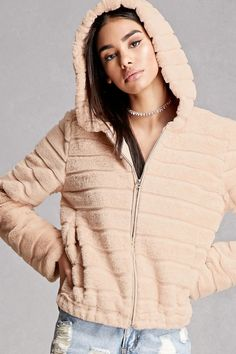 d8bde5219c4 A soft faux fur jacket featuring a ribbed pattern