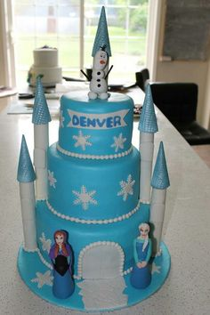 Frozen themed castle cake with edible figurines. To order email us at info@somethingsweet.ca