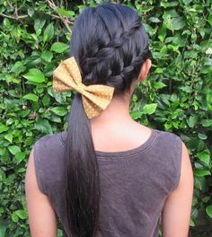 11 side ponytail with two diagonal braids