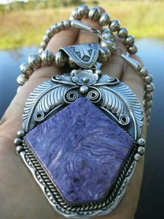 Old-pawn Navajo necklace with modern pendant set with giant charoite cabochon. Maker unidentified. Originally sold by INDIANQUEEN on Etsy.