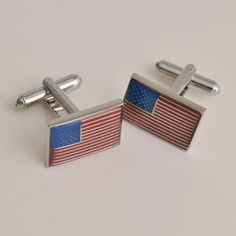 Bring a dash of patriotism to your wedding day with these American Flag Cuff Links that arrive in an engraved case [$24.95].