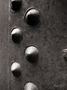 Riveting - these are just a few of the bad boys holding a pressure vessel together for an old steam powered saw - at the Yosemite Mountain Sugarpine Railroad  #monochrome photography #monochrome