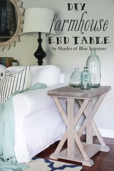 Farmhouse style X end table with light gray stained finish.