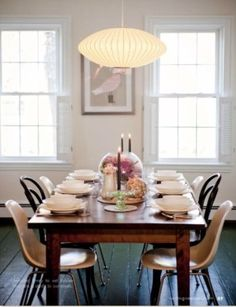 Table Setting with Fiberglass Shell Chairs and a Bubble Lamp