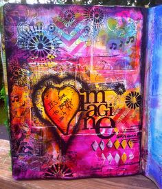 Art Journal Page paints, stencils and heat embossing