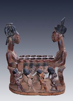 A royal ayo (mancala) game box featuring the Olowe quintessential female figures. Circa 1920