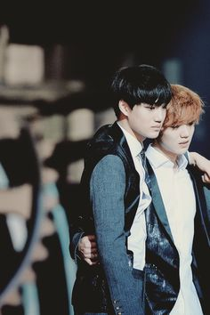 Kai and Luhan.     Kai looks really hurt look at his face and lulu helping him!. Awwwwwww.