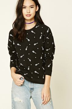 A French terry knit sweatshirt featuring a guitar print, round neckline, and long raglan sleeves.