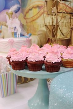 Pink cupcakes at a carousel baby shower party! See more party ideas at CatchMyParty.com!