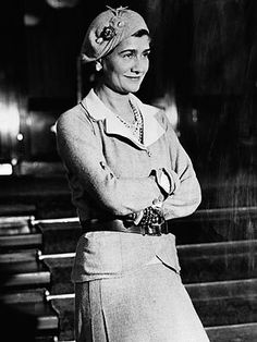 Coco Chanel in one of her signature hats
