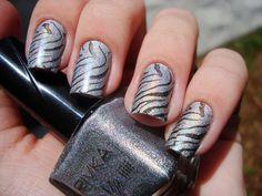 Sparkly zebra print nails