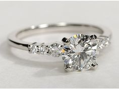 """Petite Diamond Engagement Ring in Platinum pretty, but """"petite"""" and """"diamond"""" do not go together when it comes to engagement rings."""
