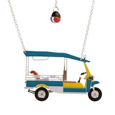 Golf Cart Pendant Necklace, by Les Nereides. how funny is this, it looks like the little cars you drive around Capri.