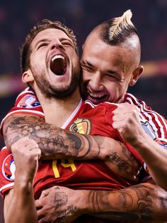 Belgium's Dries Mertens, left, celebrates with teammate Radja Nainggolan after scoring against Israel during a Group B Euro 2016 qualifying soccer match in Brussels, Belgium. Football Jerseys, Football Soccer, Dries Mertens, Uefa Euro 2016, Soccer Match, As Roma, Best Player, One Team, Soccer Players