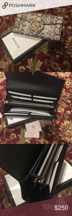 NIB Gucci GG Marmont Python Wallet Brand new with box Gucci GG Marmont Python Wallet.  Please don't ask the obvious, it is an inspired item, but absolutely gorgeous with cream pearls. Genuine leather. Would make a beautiful Mother's Day gift to your mom or yourself!  Happy Shopping!! Gucci Bags Wallets