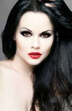 How is anybody THAT pale!?! I love the dark hair, and pale skin. The eye color is amazing, too.