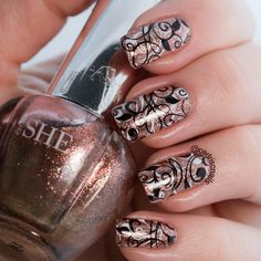 SHE rose gold polish double stamped with Uberchic beauty 1-01 and nail stamping queen  black and white stamping polish.