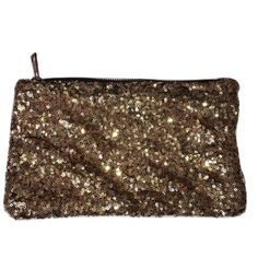 Gold Sequence Zip Up Clutch NWOT Super cute gold sequenced zip up clutch. Unknown brand Leopard print lining Small inside pocket with zipper Loose ripple fabric effect on front Brand new never used. Bags Clutches & Wristlets